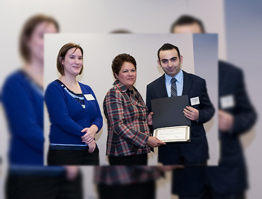 Behzad with a Chicago Consular Corps Scholarship with two officials